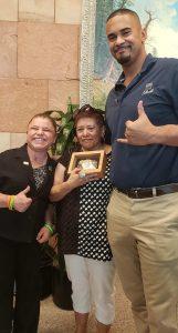Sara Millard (a kidney transplant recipient) poses with Ruth Sena, her donor's mom and former Denver Bronco, Ryan Harris.
