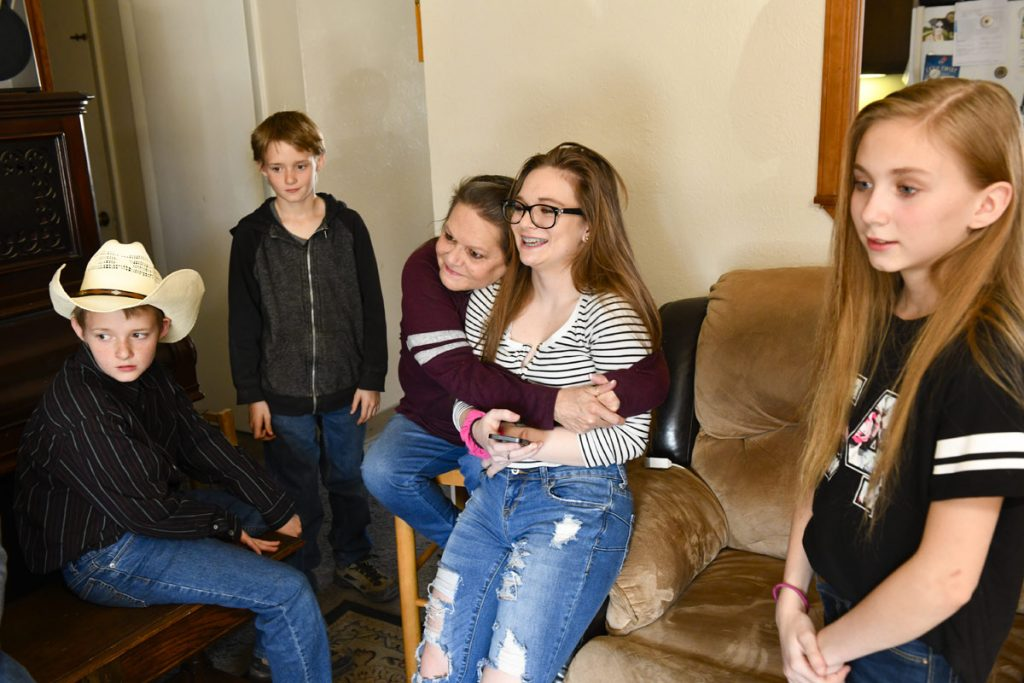 Connie Parke used to be blind woman, but recently got her vision back. Here she is pictured with multiple grandchildren.