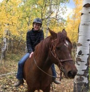 Kristina Mitchell rides her horse, Jazz.