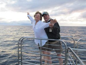 "In this photo, Connie Kassel and Bob Bryant reenact the iconic ""I'm Flying!"" scene from the movie Titanic while on a boat in Hawaii."