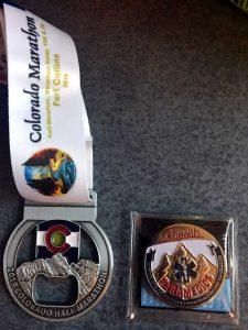 Colorado Marathon medal next to the UCHealth Paramedic coin