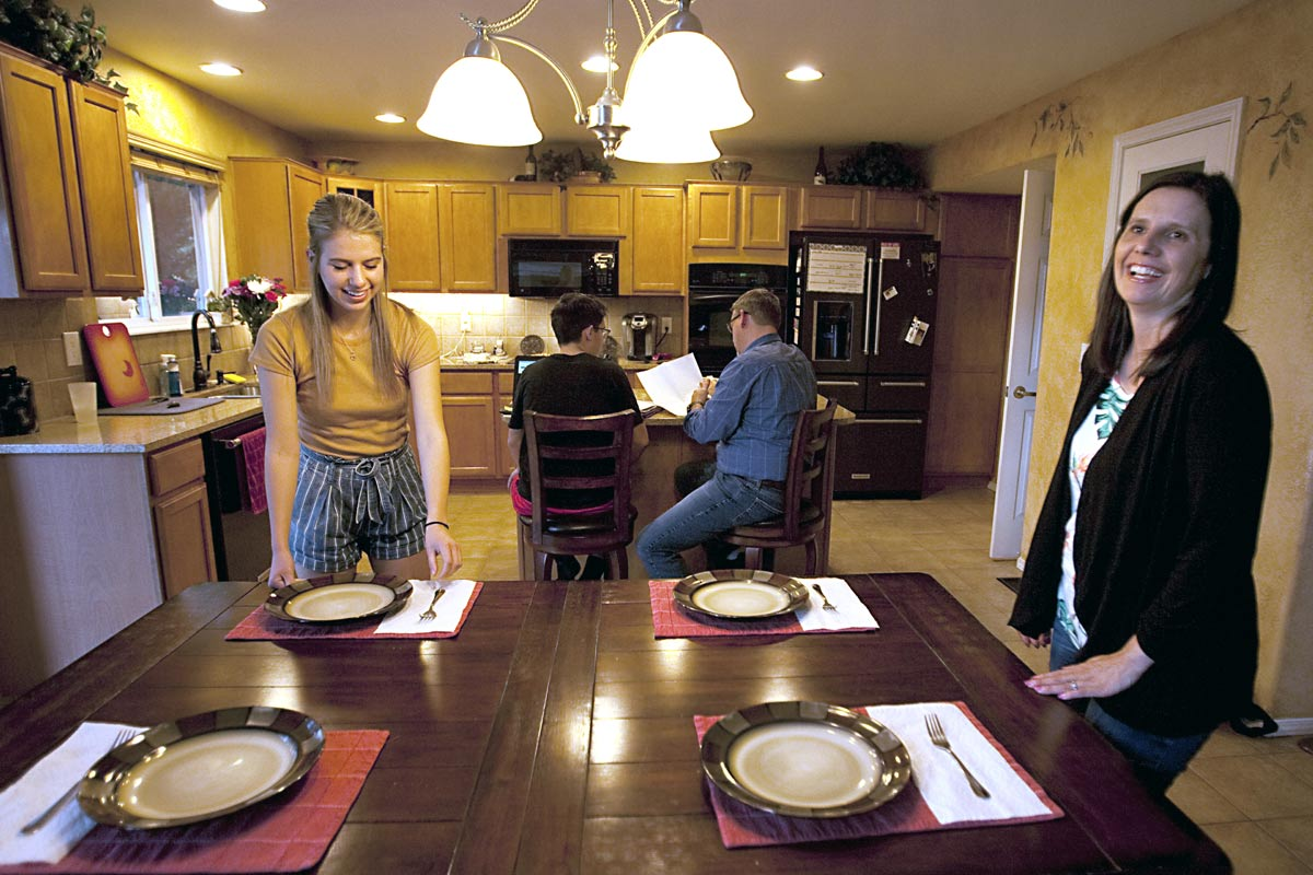 family working in kitchen