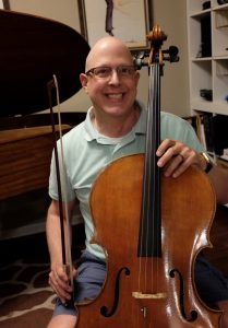 Michael Rector poses with his cello.