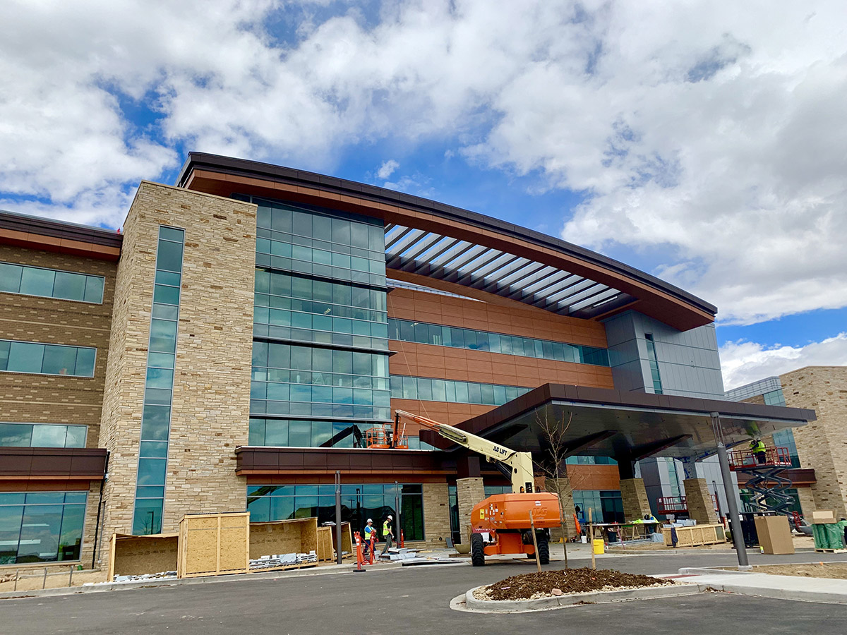 Crews work on finishing touches outside new hospital building.