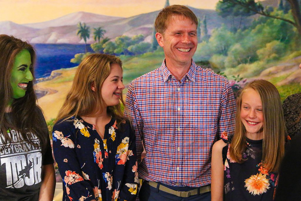 This is a photo of Todd Danielson, daughters Harper and Finely, and the actress who played Elphaba in the production of Wicked.