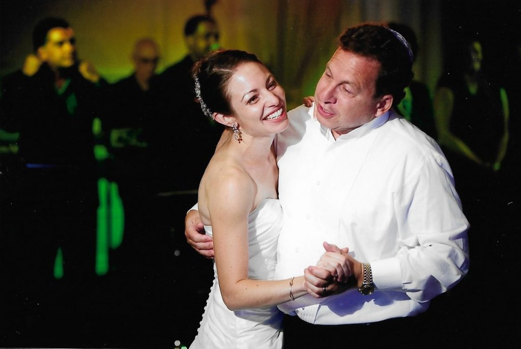 Dr. Hillary Yaffe dances with her dad at her wedding. Dr. Yaffe donated part of her liver to save her dad's life.