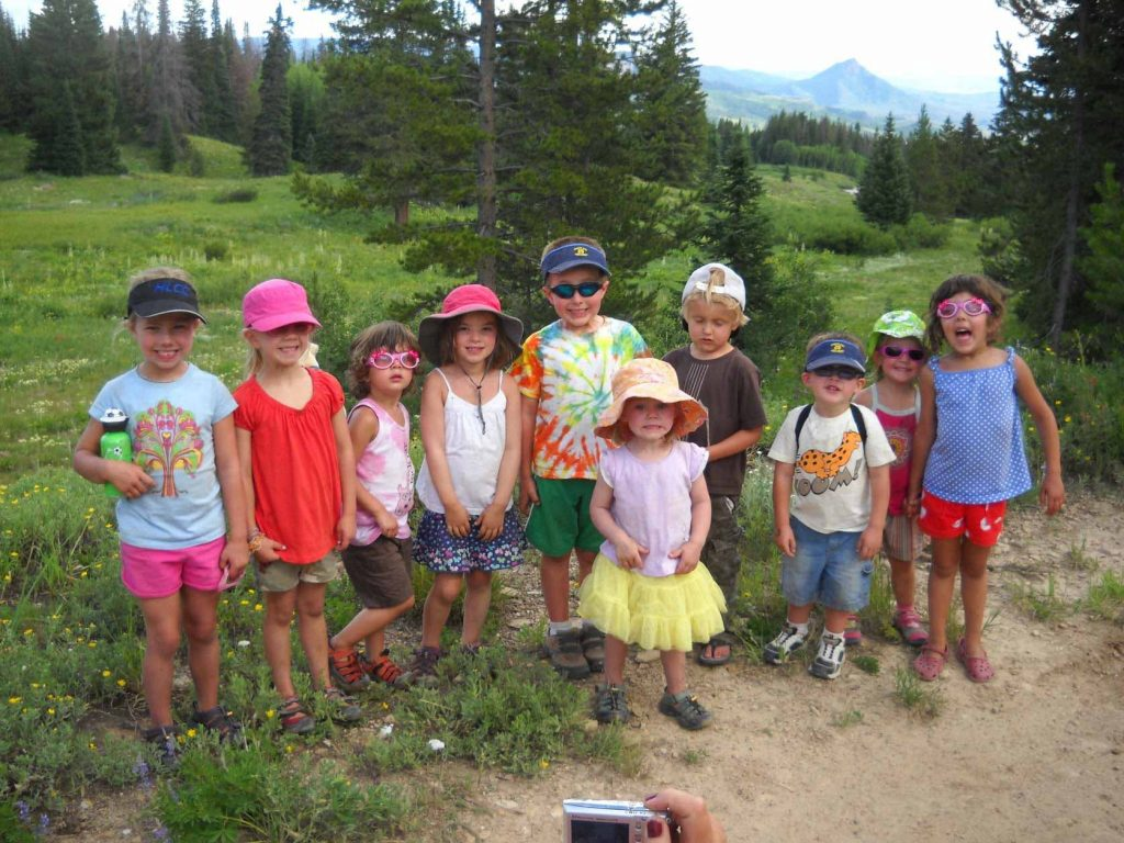 A big group of children camping together, their parents whom created the kid camping kit together.