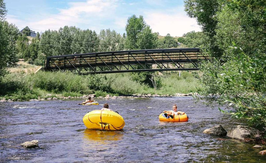 tubers float on a Colorado summer tubing river.