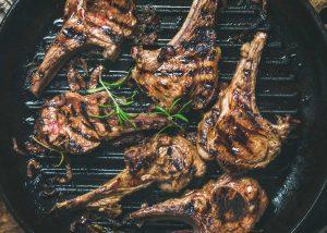 Lamb chops on a grill.