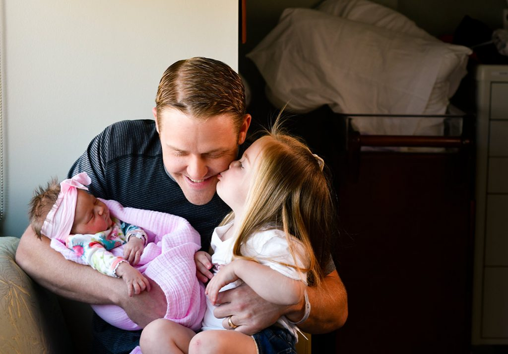 Doug Burford with his two daughters, Hadley and newborn, Eloise, the first baby born in Highlands Ranch