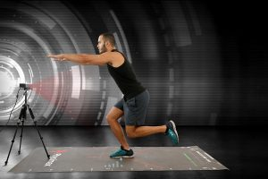 An athlete is video-taped performing exercises in this photo.