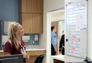 nursing looking at white board.