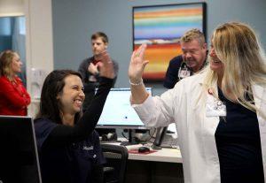 two nurses high-fiving