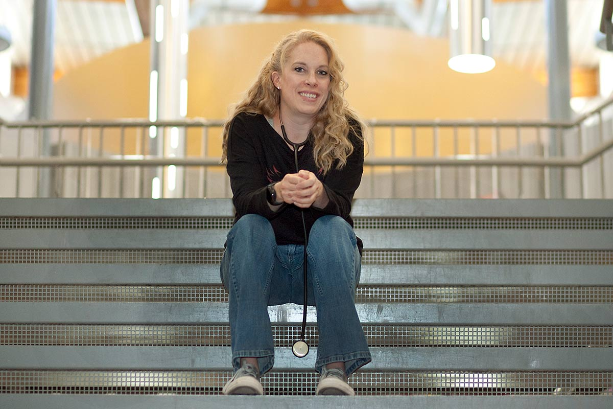 Brandi sits on the steps inside the school