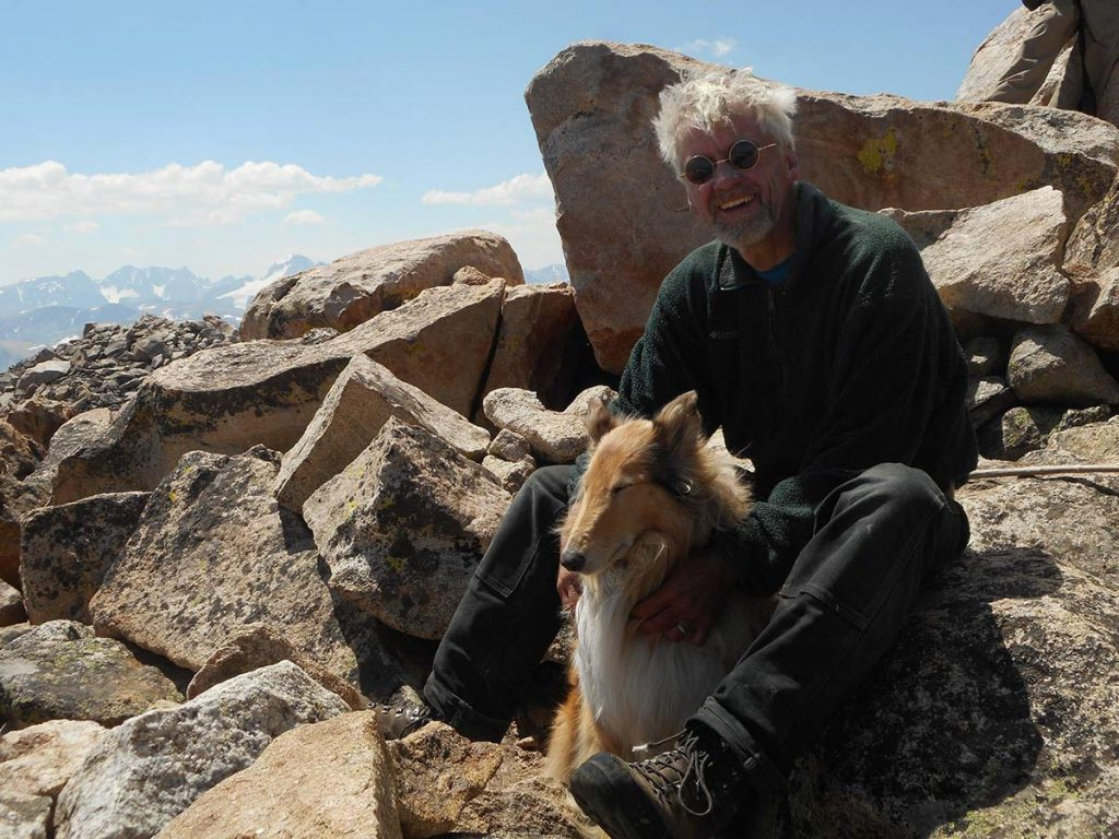 Joe Boardman backpacking with his dogs