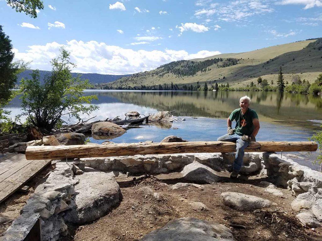 Joe Boardman building a cabin in Wyoming.