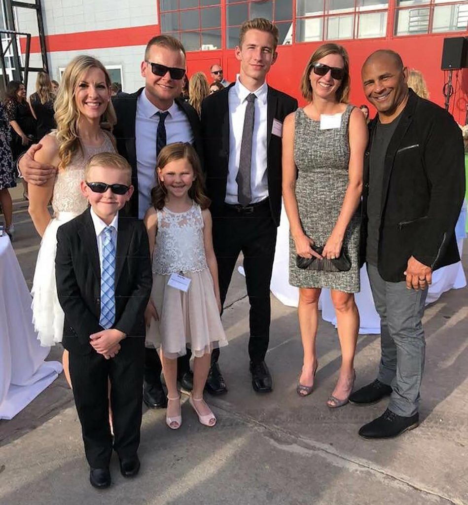 Liver transplant donor Jeff Bramstedt and his wife with liver transplant recipient, Melinda Ray, and her husband and children