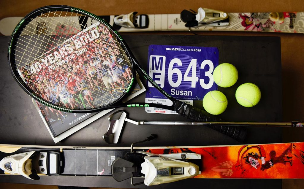 Susan High loves a variety of sports from skiing to tennis to running. A collage shows some of her sports equipment.