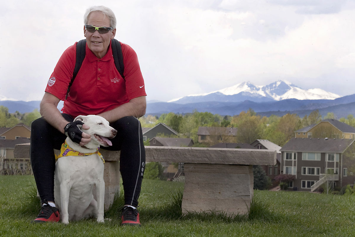 Steven Rutledge sits on a bench with his dog after having a procedure to correct an abnormal heart rhythm.