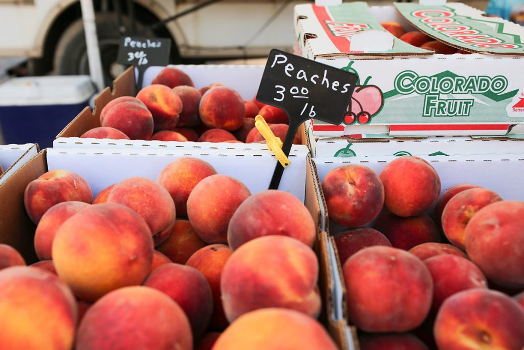 Boxes of fresh Colorado peaches