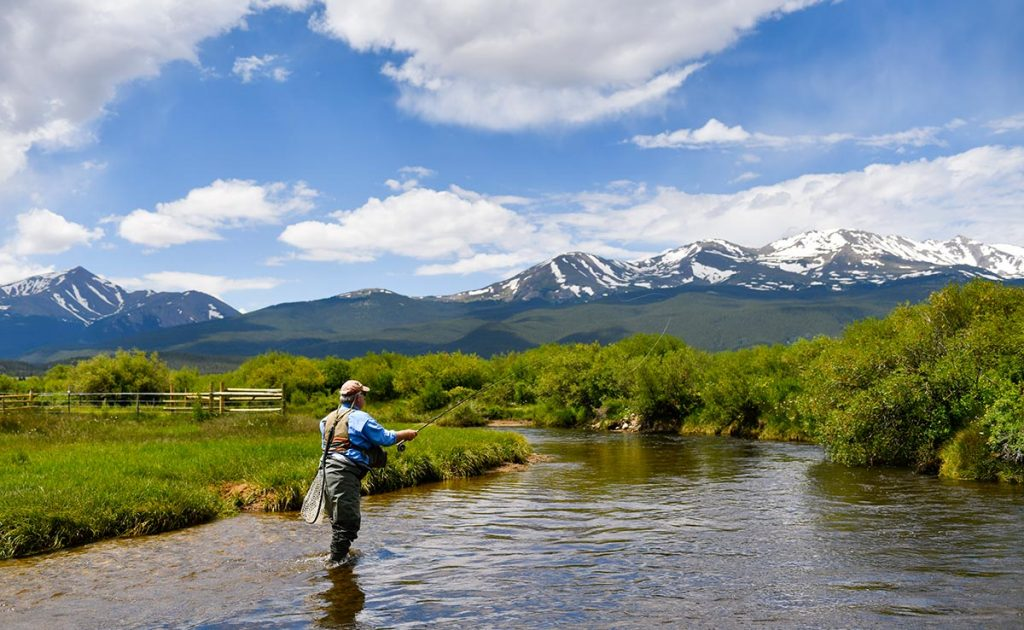 Fisherman Charles Duke casts in a tributary of the Arkansas River with Mt. Massive in the background.