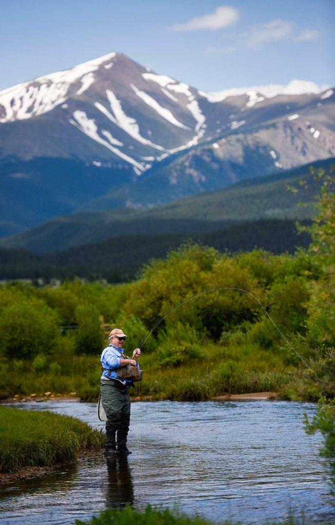 Charles Duke fishing in a tributary of the Arkansas River