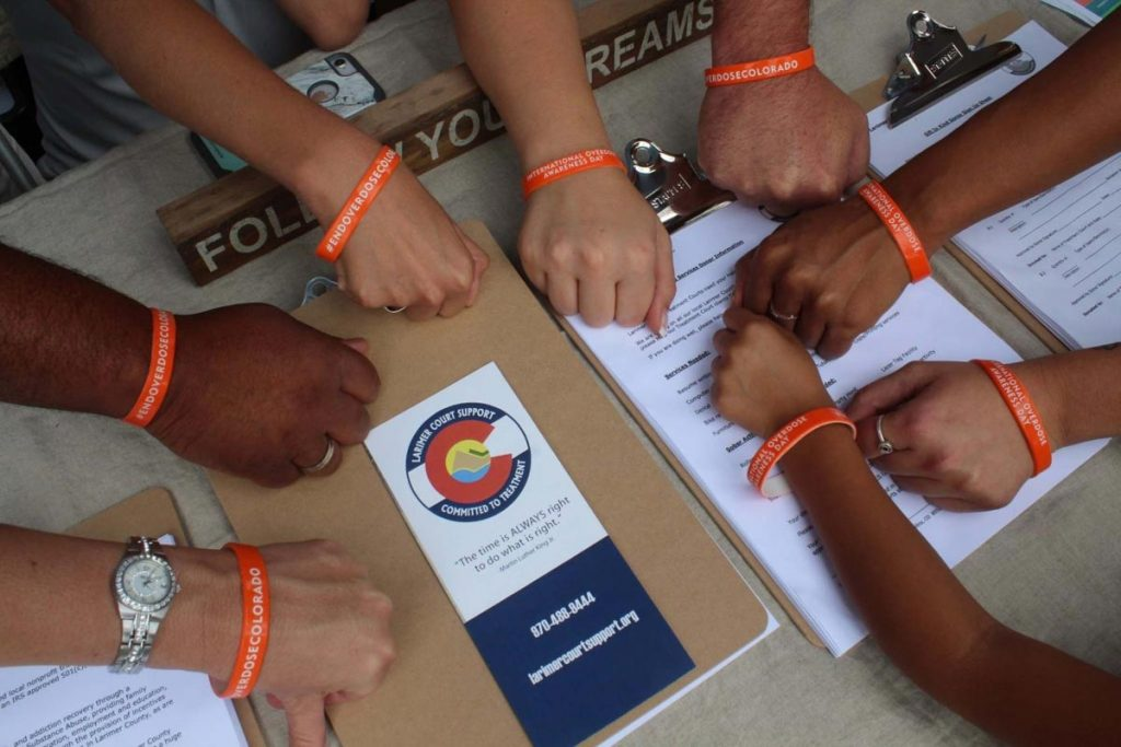 eight hands with bracelets to end overdoses in Colorado