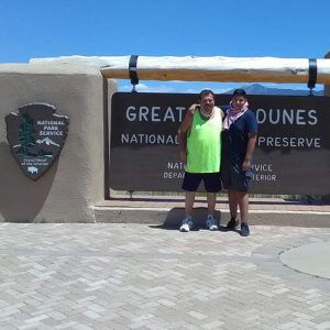 father and son in front of San Dune sign