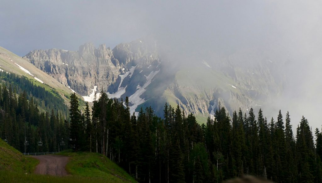 view of mountains through a misty cloud on a free gondola in Telluride, Colorado