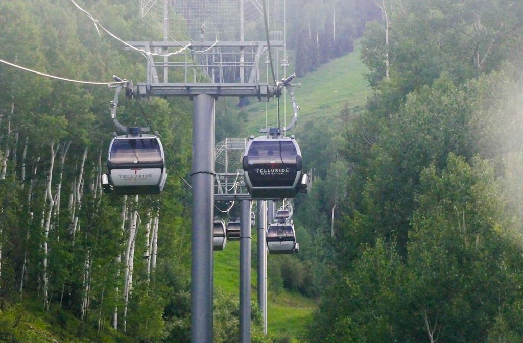 a view of gondola cabins at Telluride on a summer day. Telluride has one of Colorados free gondolas.