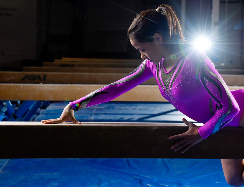 Olympic gymnast Jessica Lopez poses on the balance beam.