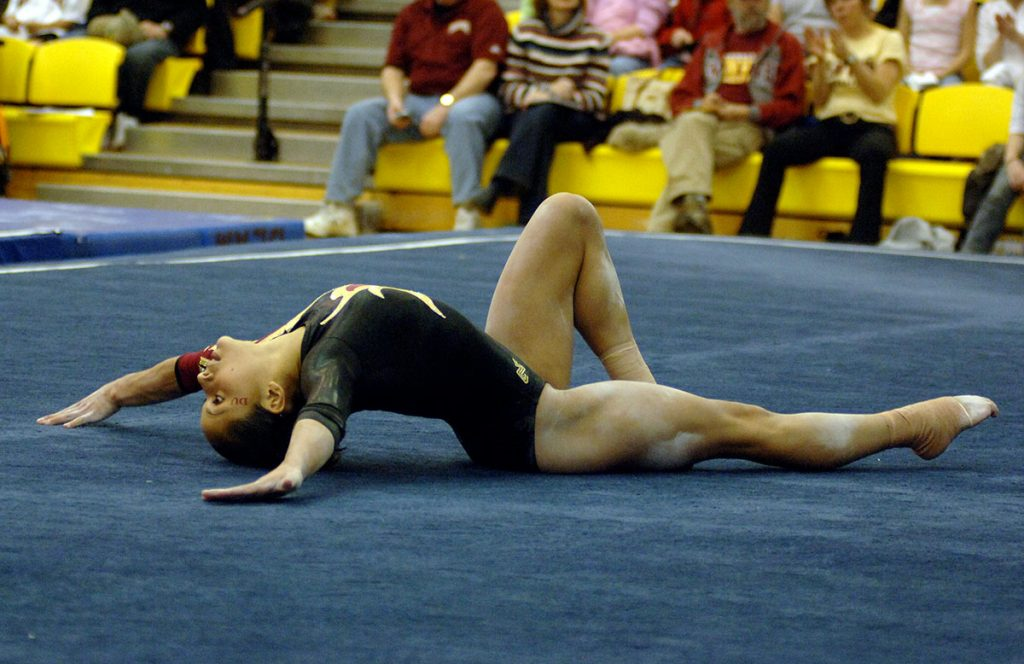 Olympic gymnast Jessica López competes in floor exercises during college.