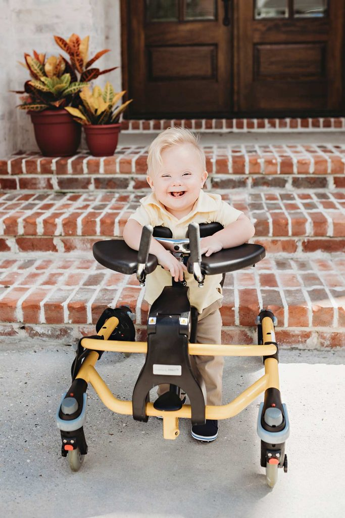 Despite heart problems, Hudson is ready to be a poster boy. Here, he practices standing in his trainer.