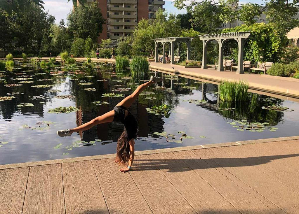 Olympic gymnast, Jessica López, shows off a handstand at the Denver Botanic Gardens