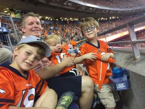 Oliver Durkee with his brothers at a Bronco game