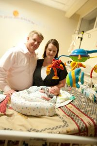 Libby and David Durkee in the NICU at UCHealth University of Colorado Hospital with Oliver, then two-and-a-half months old. Photo courtesy of Libby Durkee.
