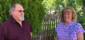 Gary Hall and his wife, Nancy Hall, in the back yard of their Pueblo home.