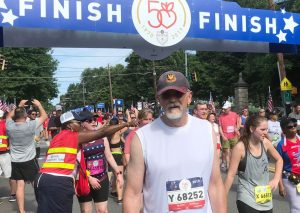 "Dr. Harold ""Corky"" Dillon at the finish line after a long, hot race in July."