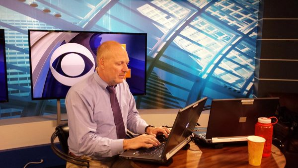 Dave Hnida at work as medical editor for CBS4 in Denver. This summer, Hnida found himself in the role of patient after suffering a heart attack that led to a heart transplant.