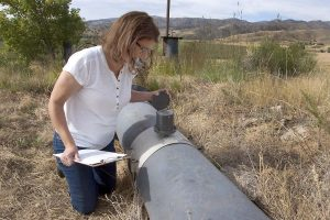 Kim looks at a water meter reading 11 months after her brain tumor was removed.