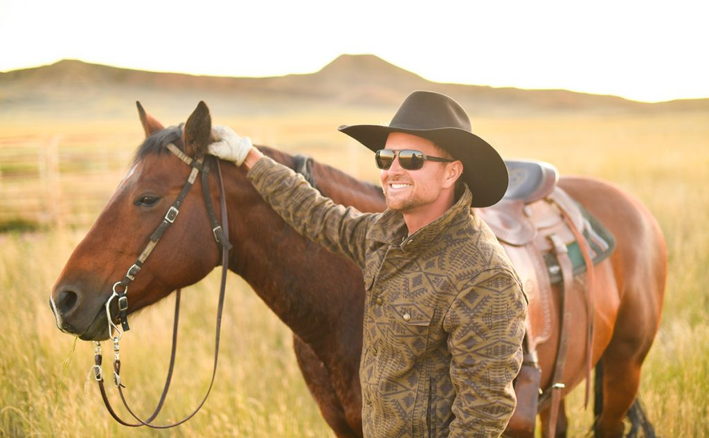 Rancher Nathan Kissack beat blood cancer. Here, he's with his horse, Dixie, at his parents' ranch in Gillette, Wyoming.