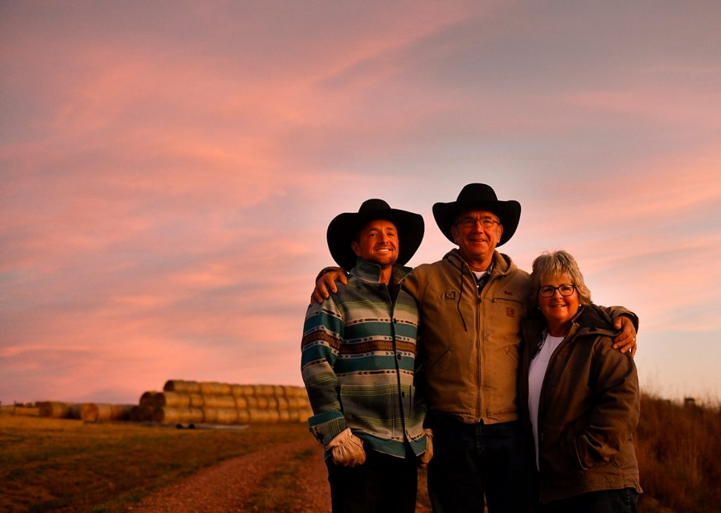 Rancher and cancer survivor, Nathan Kissack with his mom and dad, Bart and Kathy Kissack, at sunrise in Wyoming.