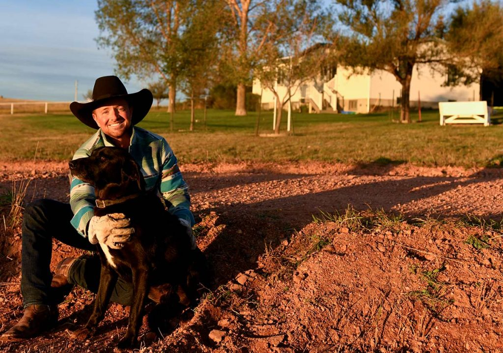 Rancher Nathan Kissack with his black lab, Nightlinger.