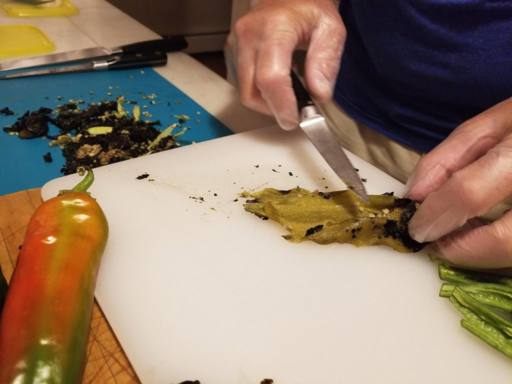 Cooking with fresh chiles. Wear gloves when scraping and cleaning chiles