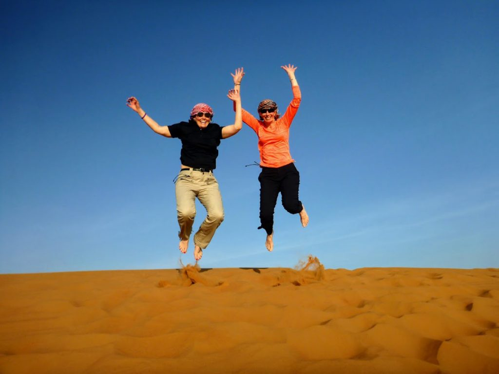Surviving pancreatic cancer. Marybeth Hoffman jumps in the sand on a trip to the Middle East with her wife, Terry.
