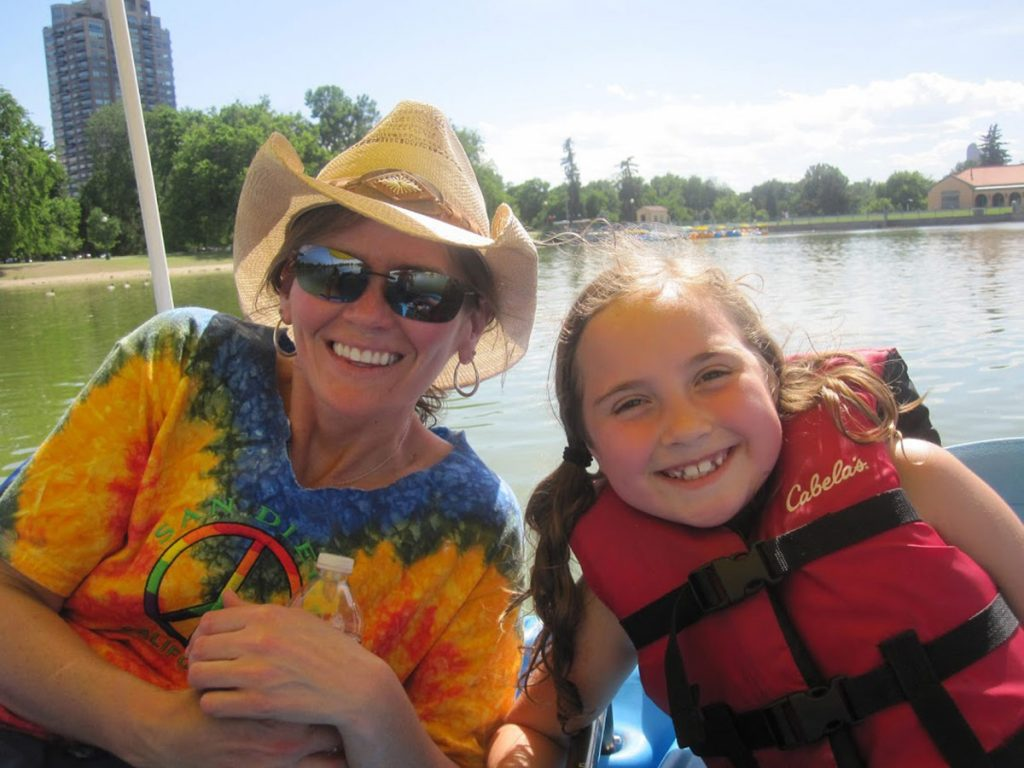Marybeth Hoffman, who is fighting pancreatic cancer, poses with her niece. They are sittign in a boat.