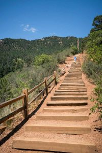 women running up the manitou incline on a summer day.