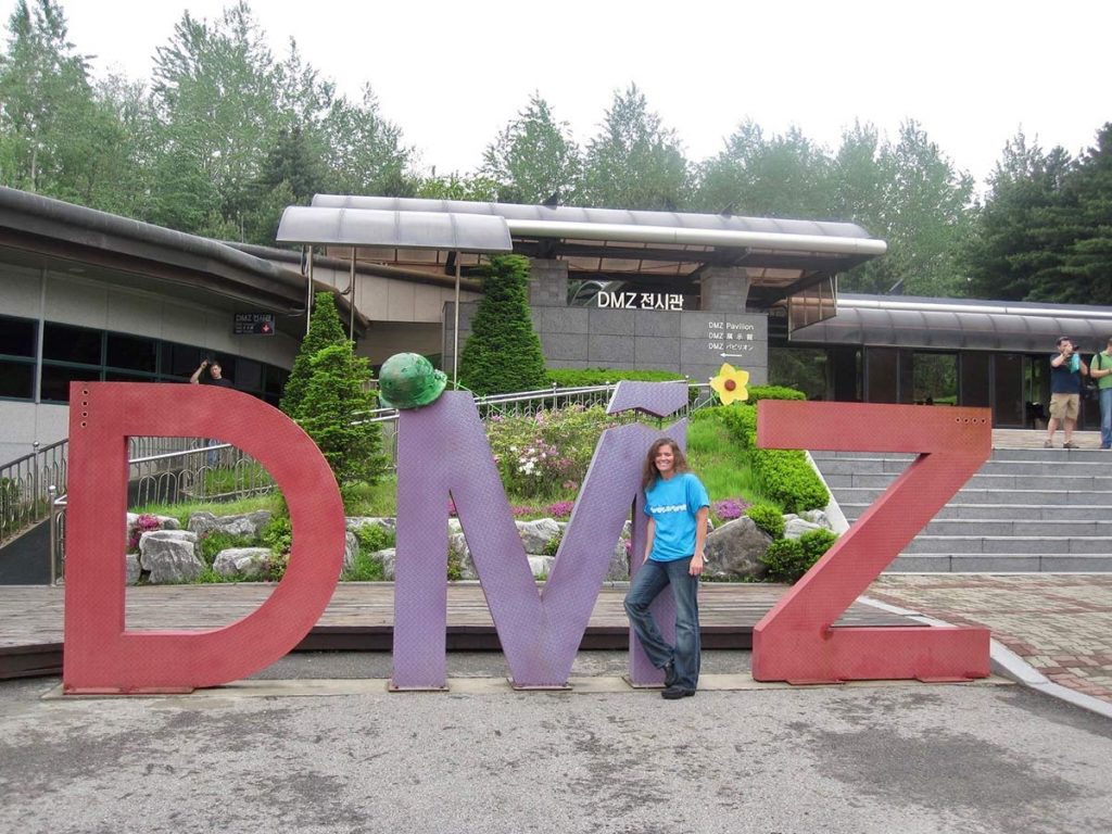 Marybeth Hoffman posing in front of the DMZ sign