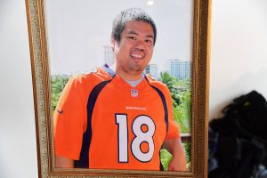 A portrait of Shakespear Log, a transplant donor, who loved Peyton Manning and the Denver Broncos.