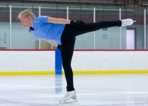 skater in mid spin on ice after recovering from talus fracture.